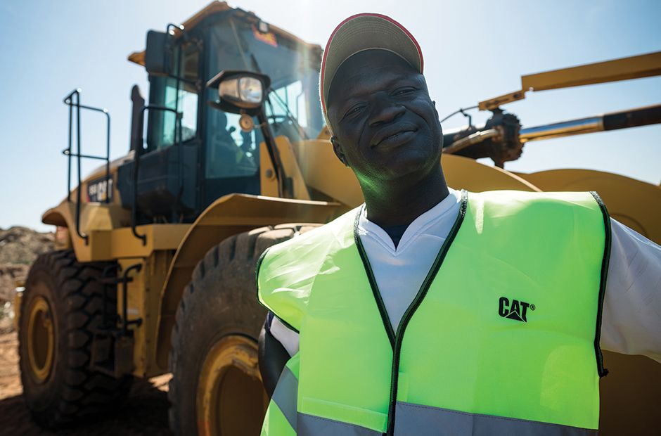 Technician in front of a wheel loader