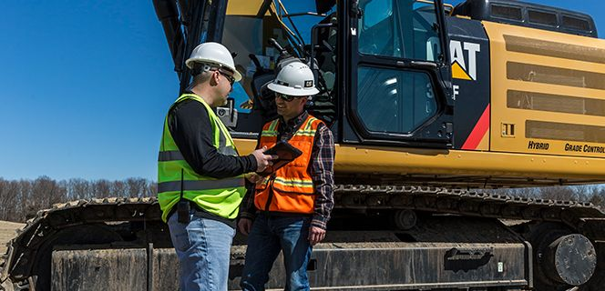 Two Operators Looking at a Phone