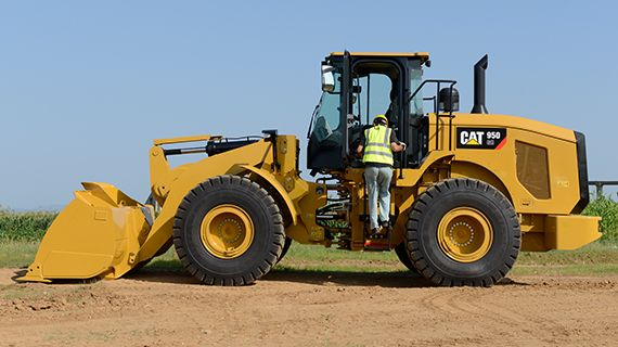 Operator getting into 950 GC wheel loader