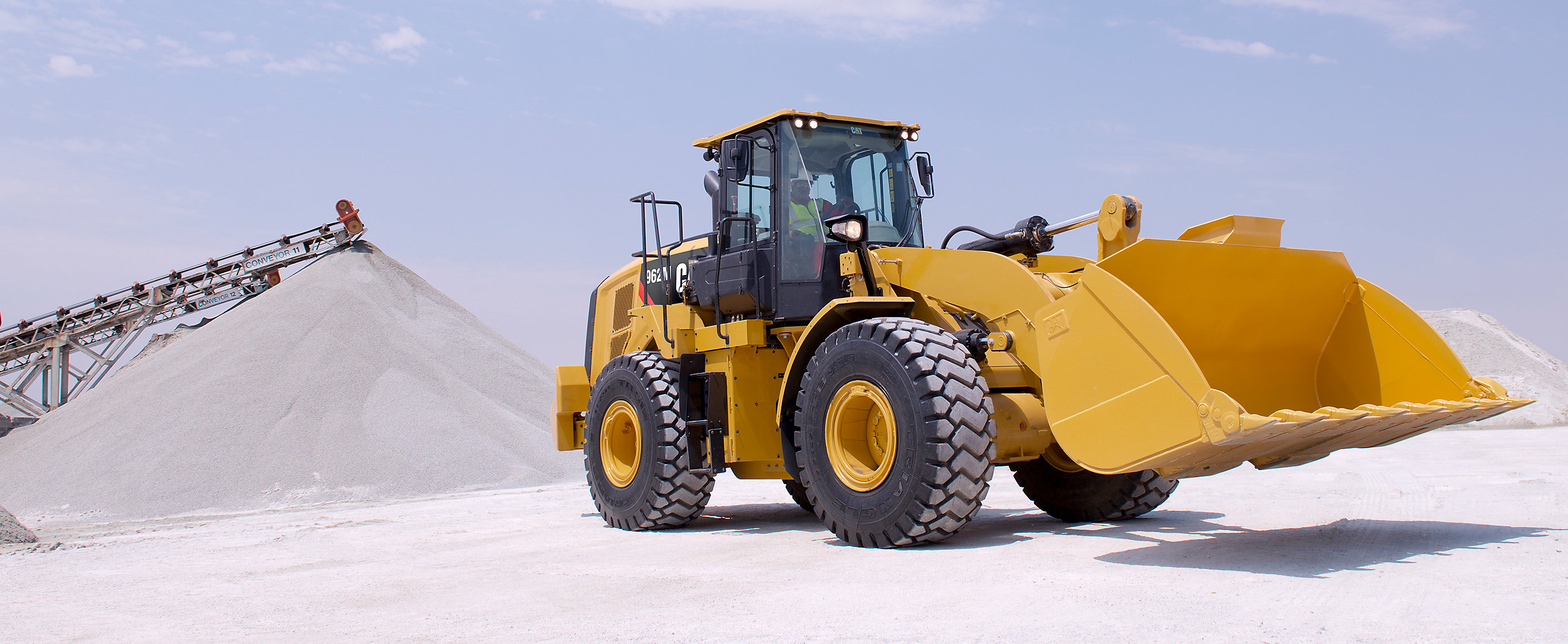 Cat® wheel loaders handle and load material safely, quickly and precisely.