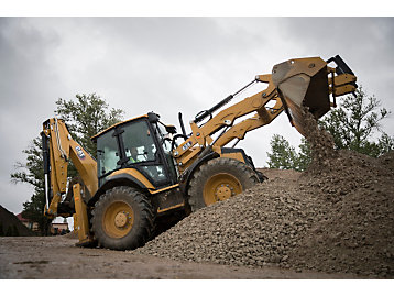 The Cat 432 backhoe loader