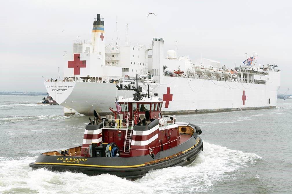 Tugboat assisting USNS Comfort