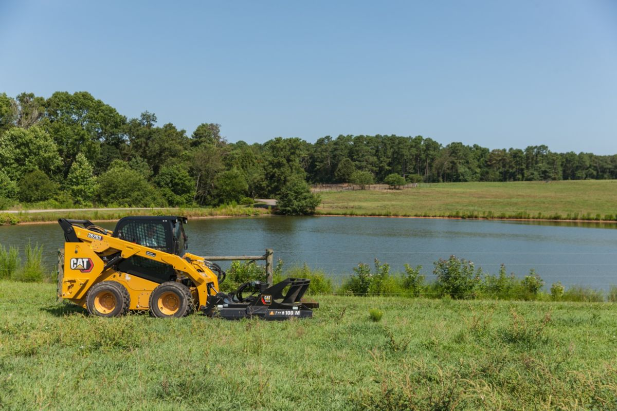 A skid steer loader with a brushcutter