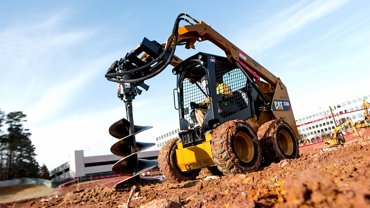 Skidsteer using work drill tool