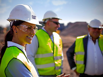 Female customer on jobsite with two male colleagues