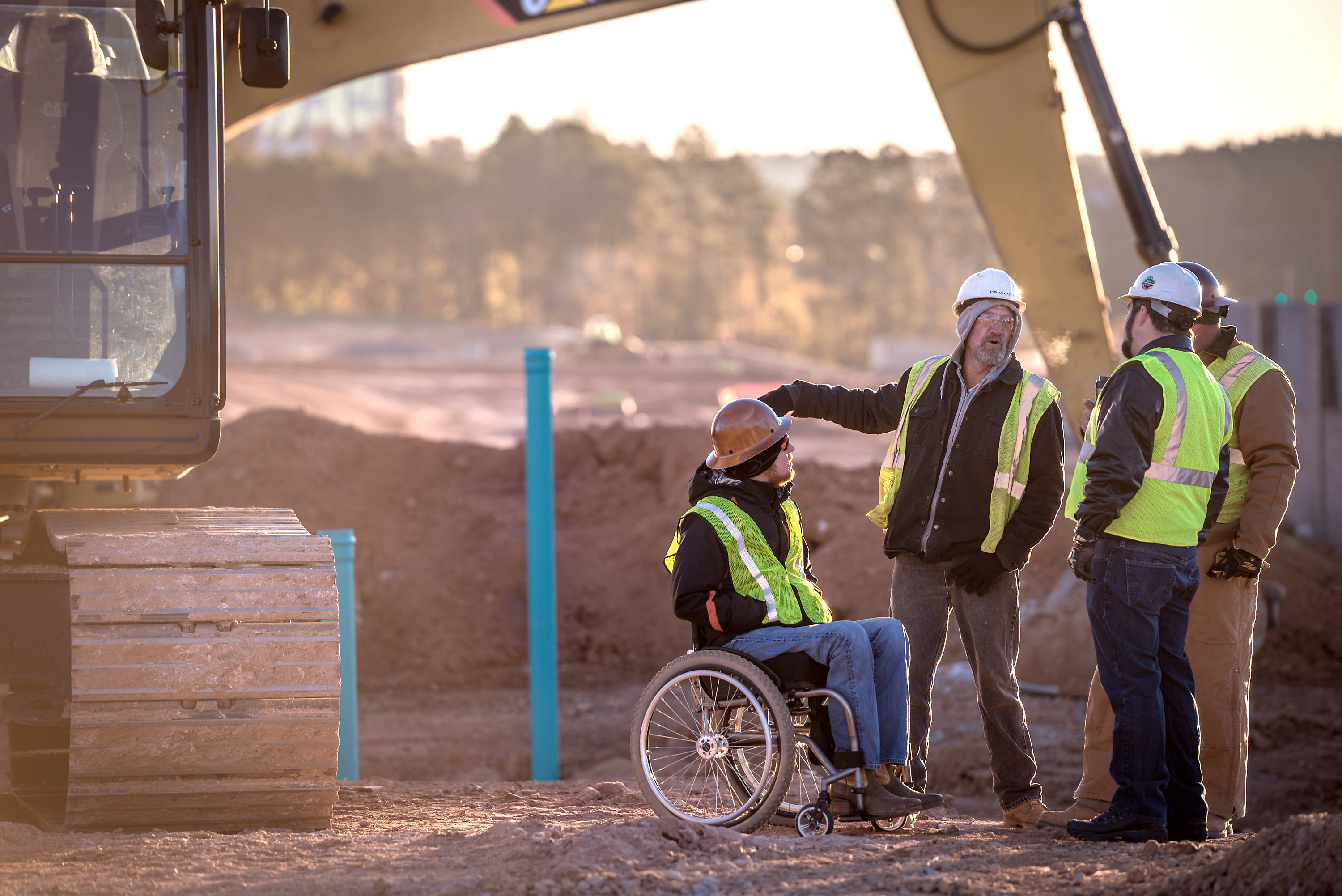 operators on a jobsite, one in a wheelchair