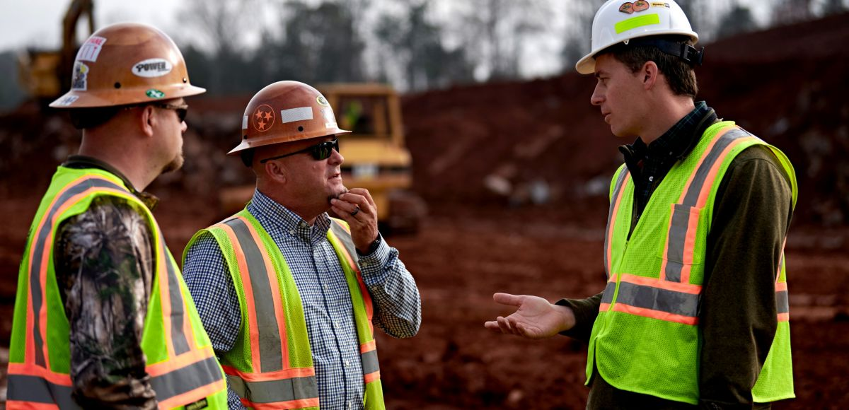 Two customer and dealer rep meeting on jobsite