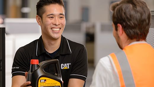 Dealer parts and service support team member showing parts