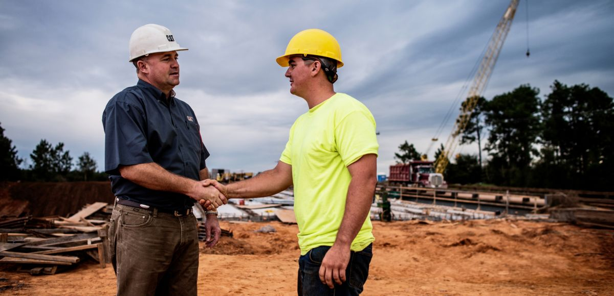 Two customers shaking hands on jobsite
