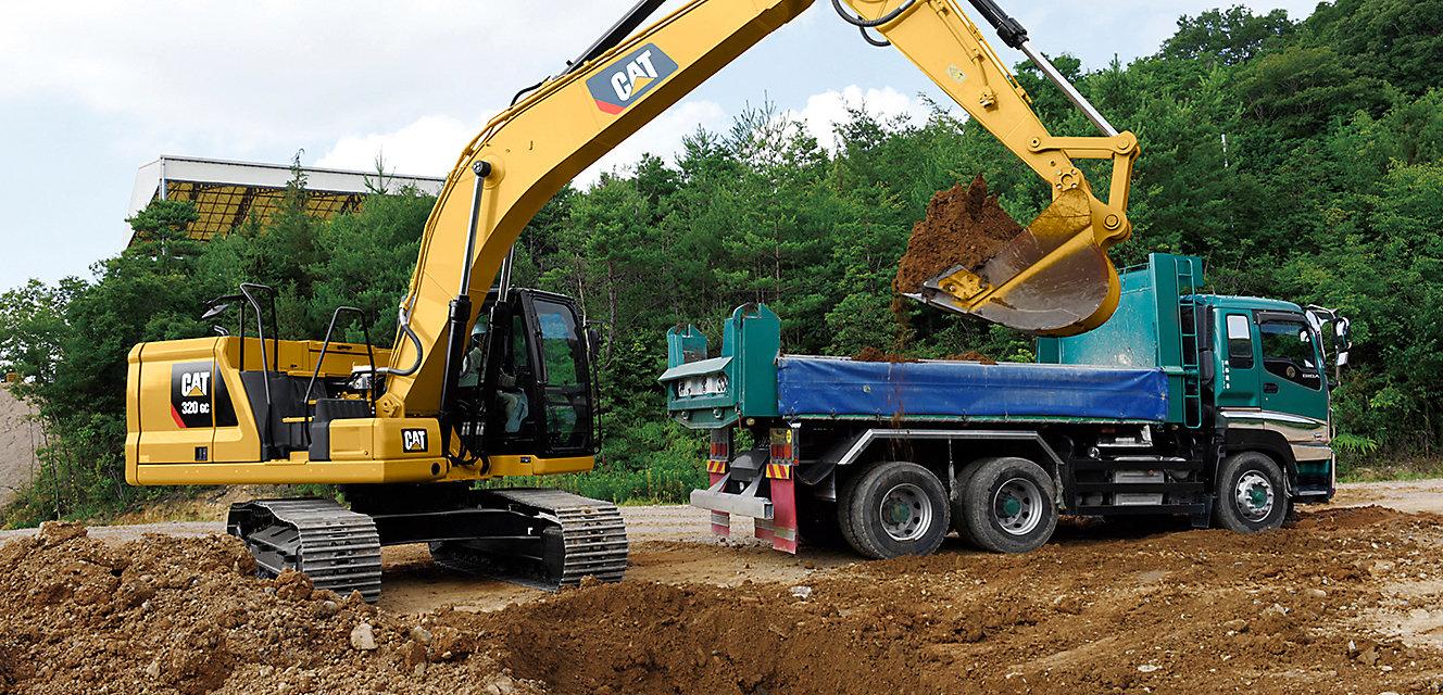 Excavator lifting dirt