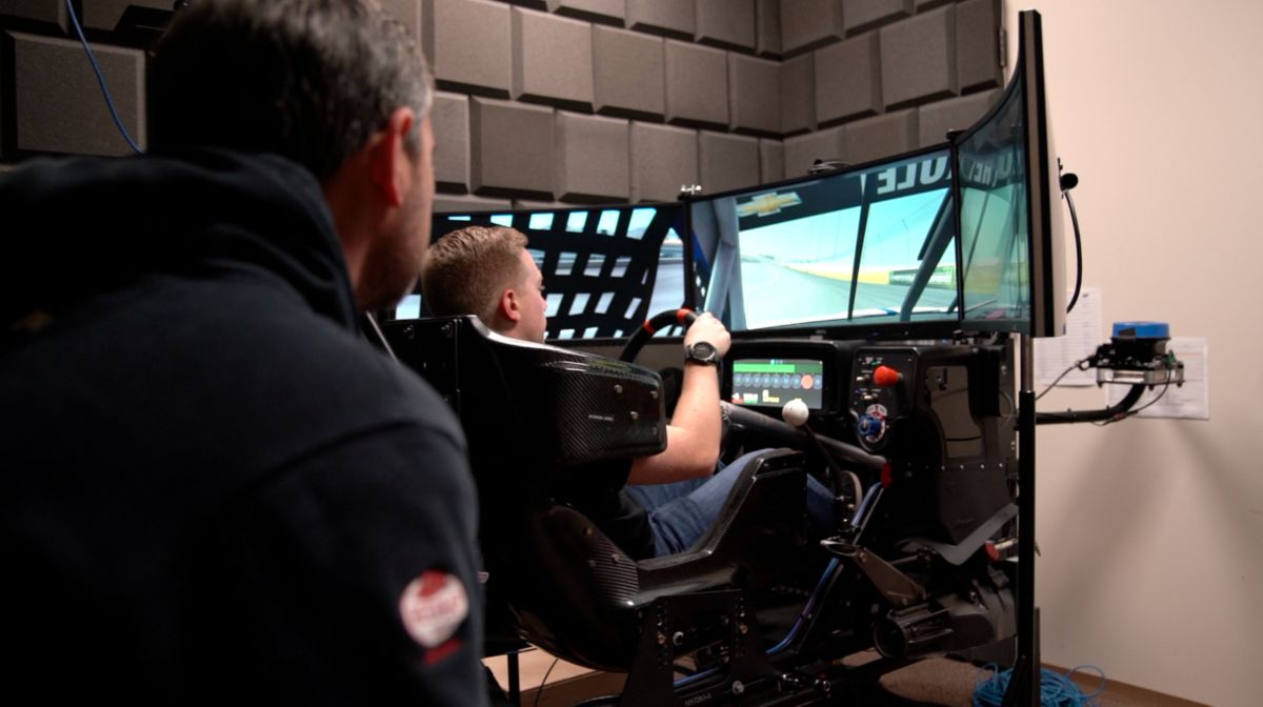 Crew Chief Randall Burnett gathering information as Driver Tyler Reddick spends time in the simulator.