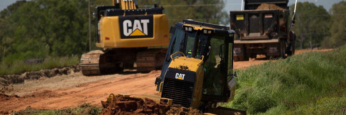 Cat machines on jobsite
