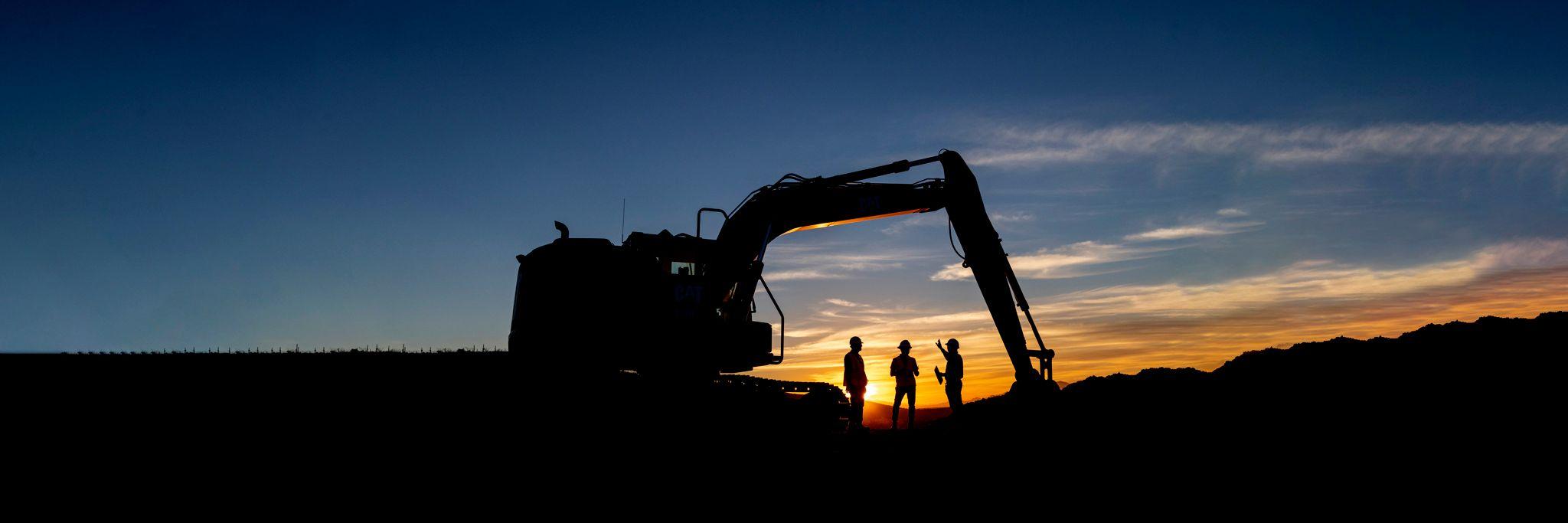 Excavator at sunrise
