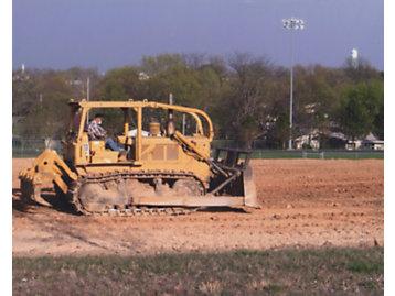 KW Nichols On Bulldozer Building High School Practice Field