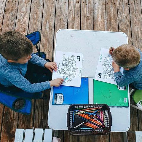 two boys coloring