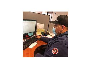 JMH employee taking online COVID training.
