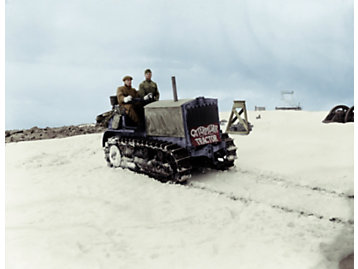 With George Rhodes at the controls, a Holt 5-Ton tractor completes its historic 1919 climb up Pikes Peak.