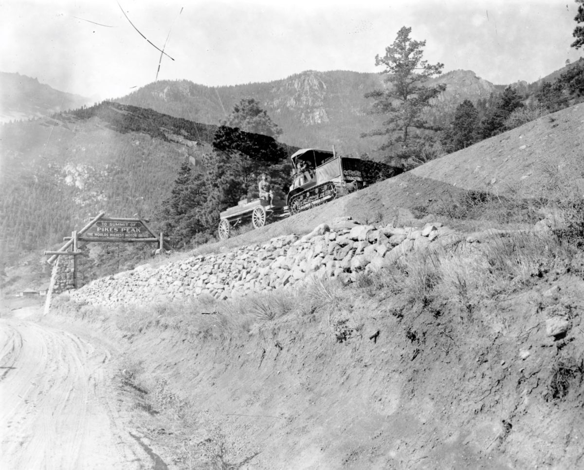 Up the spiraling 16-mile road to the peak, the Holt 5-Ton tractor climbed. Despite uncleared, snow-packed roads for the last two miles, the 5-Ton tractor made the ascent to the tip of the peak and came back down within one day.