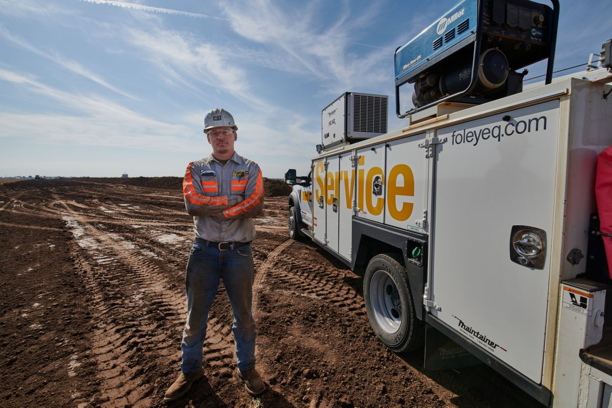 Technician by a service truck