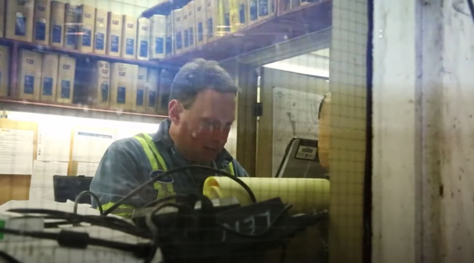 Technician Working On Machine Parts