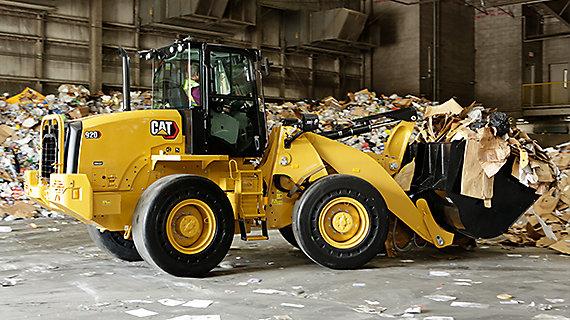 920 compact wheel loader hauling waste