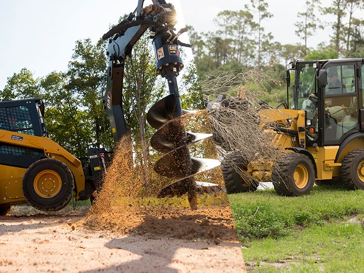 How to Choose Between a Skid Steer or Compact Wheel Loader for Your Landscape Business