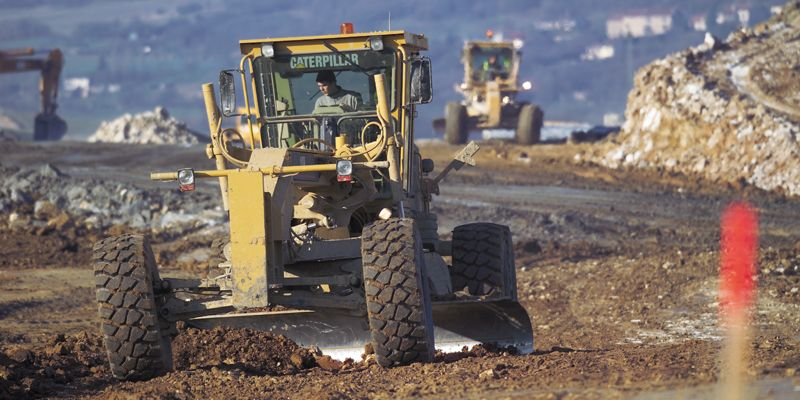 A fleet of Cat machines help construct additional lines for the Ligne a Grande Vitesse, Paris, France, 2003.