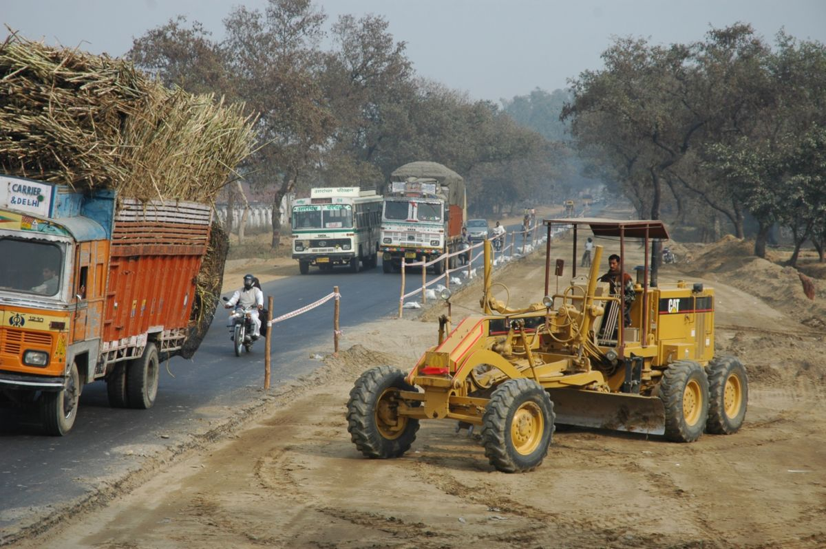 A fleet of 220 Cat machines and generator sets works on the 3,625 miles of a four-to-six lane highway known as the Golden Quadrilateral, India, 2005.