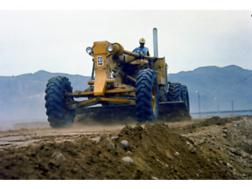 Cat 14E Motor Grader constructing the Tarbela Dam is an earth fill dam located on the Indus River in Tarbela Dam is an earth fill dam located on the Indus River in Pakistan. It's the largest earth-filled dam in the world and fifth-largest by structural volume. . It's the largest earth-filled dam in the world and fifth-largest by structural volume.