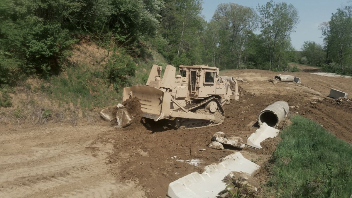 Armored D7RII Clearing Rubble