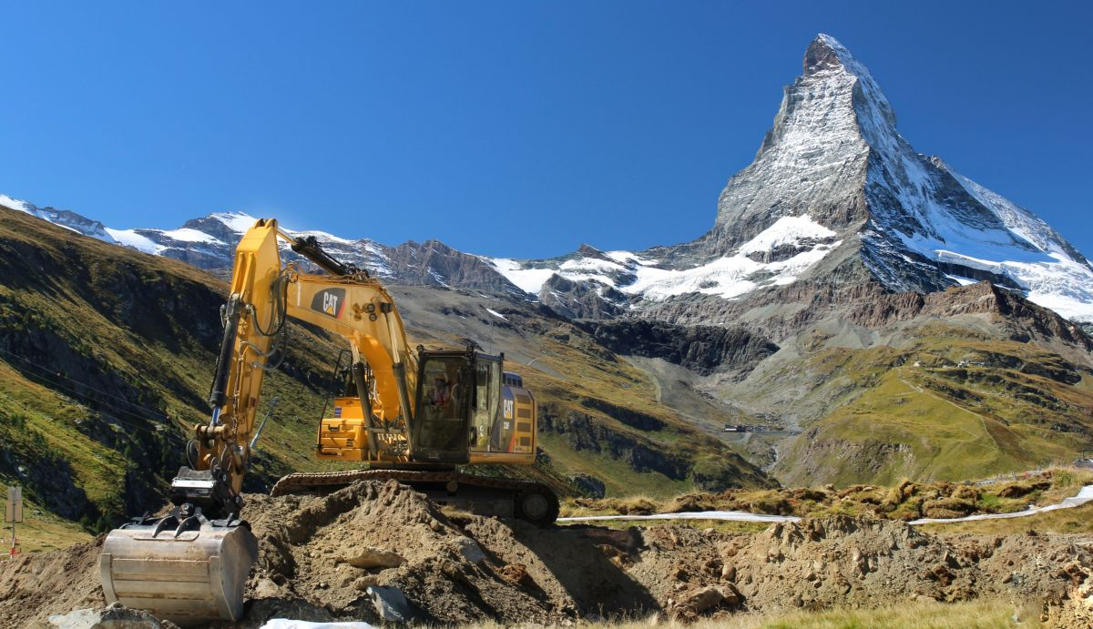 Cat Machine in front of Mountain