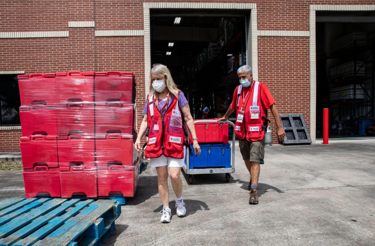 August 28, 2021. Baton Rouge,Louisiana. Red Cross volunteers JoeApicelli of Groton, CT, and Kathleen Rookof Ashford, CT, load supplies that will beshipped to emergency shelters inpreparation for Hurricane Ida. Photo Credit: Scott Dalton/American Red Cross