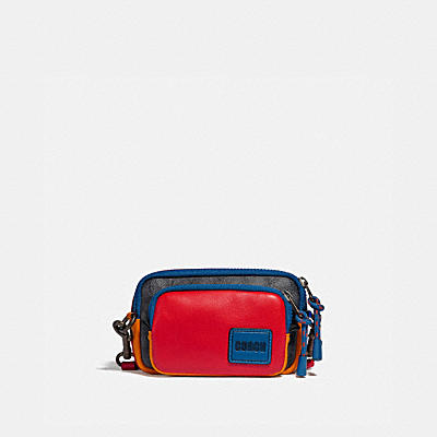 PACER CONVERTIBLE DOUBLE POUCH IN BLOCKED SIGNATURE CANVAS WITH COACH PATCH