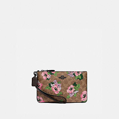 SMALL WRISTLET IN SIGNATURE CANVAS WITH BLOSSOM PRINT