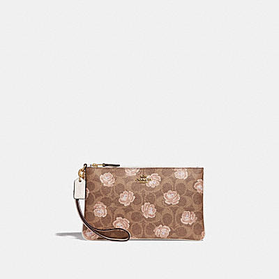 SMALL WRISTLET IN SIGNATURE ROSE PRINT