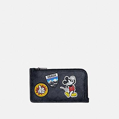 コーチ COACHのコインケース&小銭入れ |DISNEY X COACH Lジップ カード ケース シグネチャー キャンバス ウィズ スポーツ パッチ