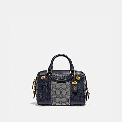 LARK BAG 19 IN SIGNATURE JACQUARD