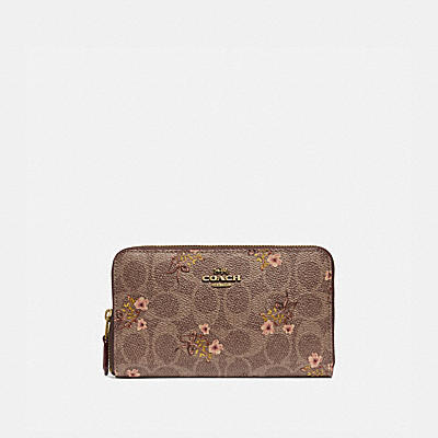 MEDIUM ZIP AROUND WALLET IN SIGNATURE CANVAS WITH FLORAL PRINT