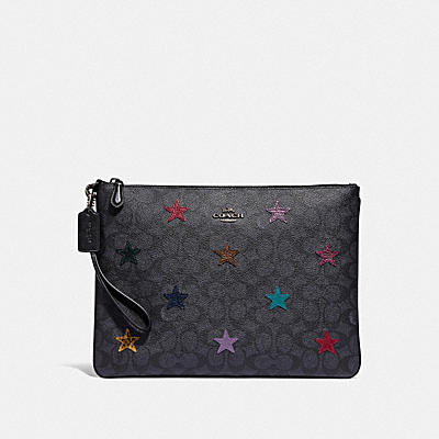 LARGE WRISTLET 30 IN SIGNATURE CANVAS WITH STAR APPLIQUE AND SNAKESKIN DETAIL