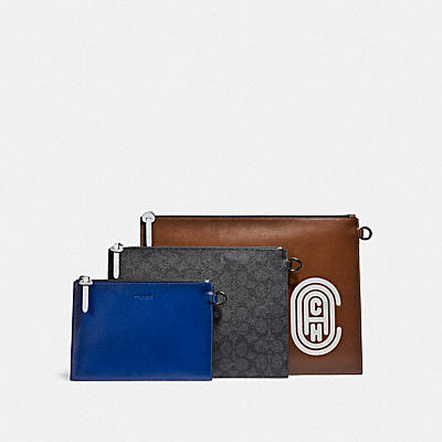 TRIPLE POUCH IN SIGNATURE CANVAS WITH REFLECTIVE COACH PATCH