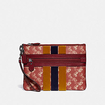 LARGE FRONT ZIP WRISTLET WITH HORSE AND CARRIAGE PRINT AND VARSITY STRIPE