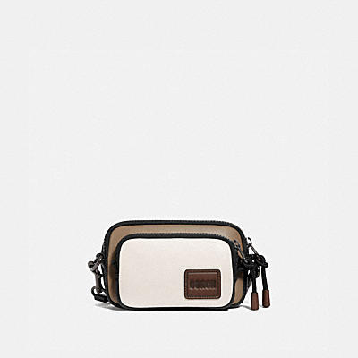 PACER CONVERTIBLE DOUBLE POUCH IN COLORBLOCK WITH COACH PATCH