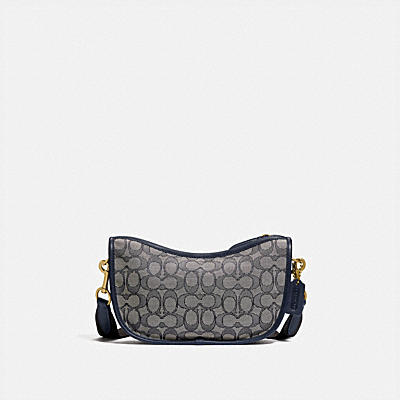 SWINGER CROSSBODY IN SIGNATURE JACQUARD