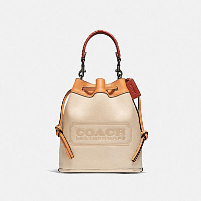 FIELD BUCKET BAG IN COLORBLOCK WITH COACH BADGE AND WHIPSTITCH