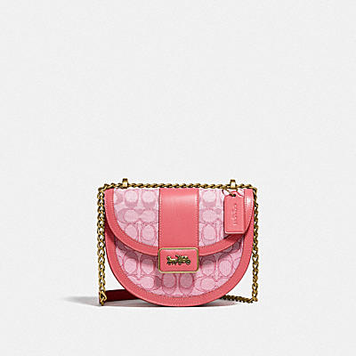 ALIE SADDLE BAG IN SIGNATURE JACQUARD