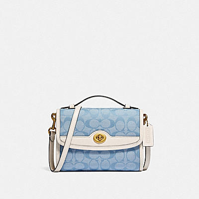 KIP TURNLOCK CROSSBODY IN SIGNATURE CHAMBRAY