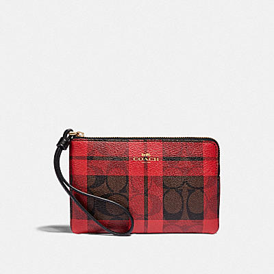 CORNER ZIP WRISTLET IN SIGNATURE CANVAS WITH FIELD PLAID PRINT