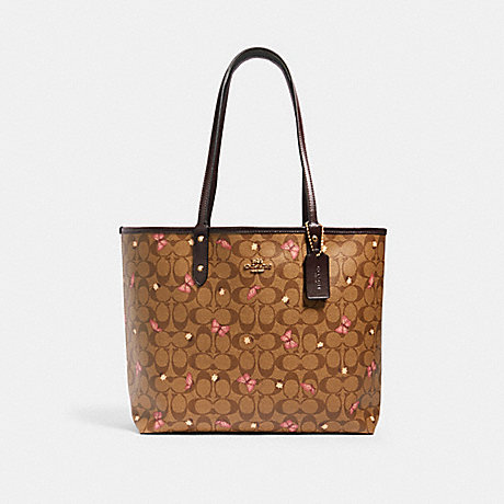 COACH REVERSIBLE CITY TOTE IN SIGNATURE CANVAS WITH BUTTERFLY PRINT - IM/KHAKI PINK MULTI/OXBLOOD - 1461