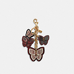 COACH 1674 - BUTTERFLY CLUSTER BAG CHARM IM/WINE MULTI