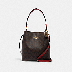 SMALL TOWN BUCKET BAG IN SIGNATURE CANVAS - 2312 - IM/BROWN 1941 RED